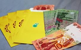 Jangan lupa simpan duit raya ya... Gambar oleh arienzackary